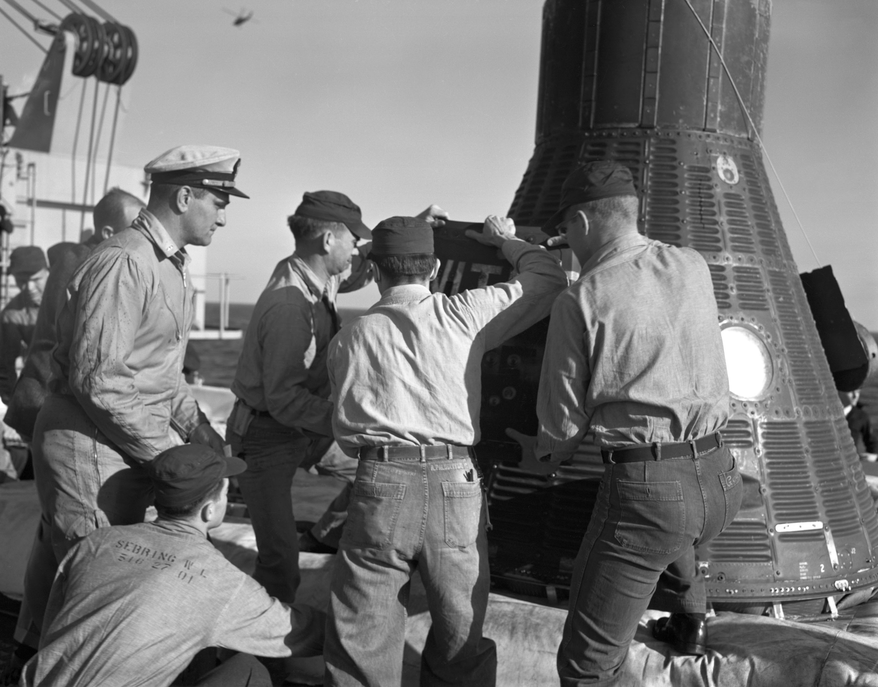 Recovery personnel aboard the USS Donner remove Ham, a 37-pound chimpanzee, from the Mercury-Redstone 2 spacecraft