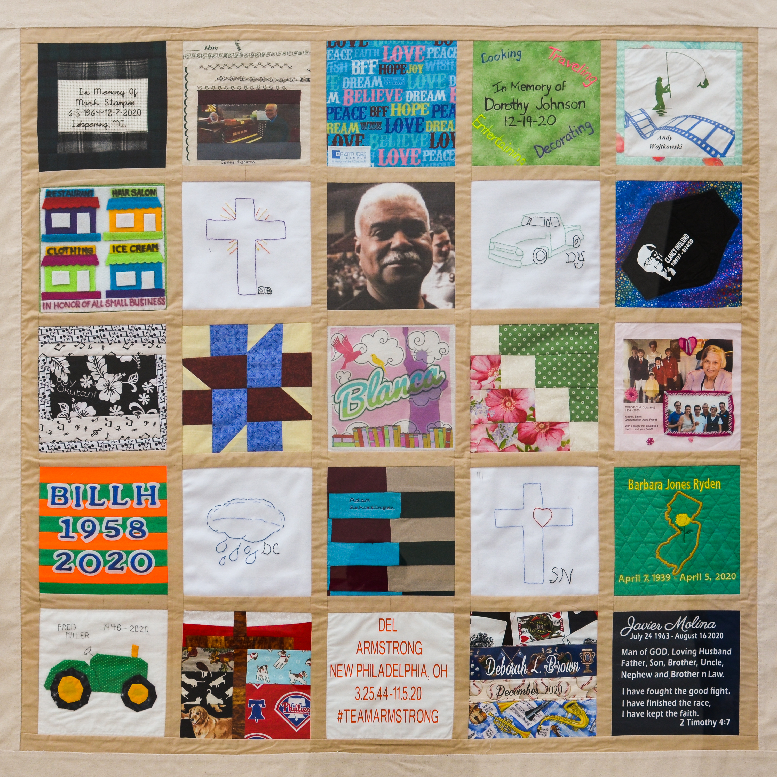 This colorful panel of the COVID-19 memorial quilt features 25 homemade fabric squares sewn in a five-by-five grid
