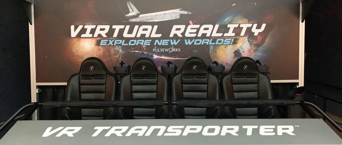 A virtual reality ride setup with four seats across