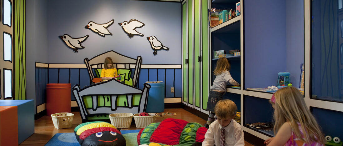 Kids playing inside Ecosystems Discovery Room bedroom