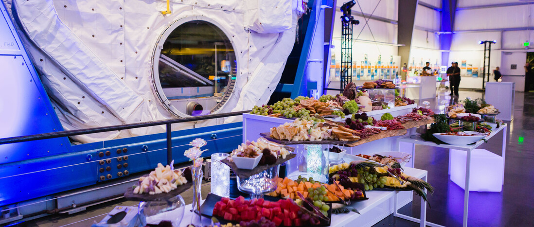 Catering Appetizer buffet of fruits, meats, and cheese in front of SpaceHab in the Samuel Oschin Pavilion